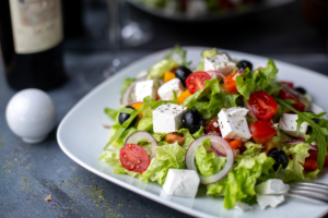 greece-salad-sliced-olives-red-wine-inside-white-plate2