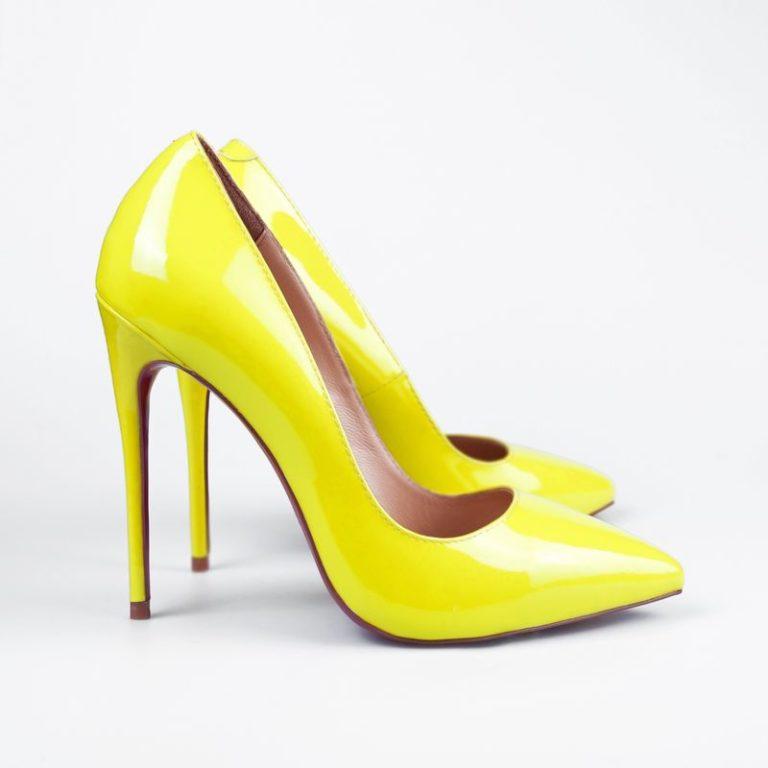 Pair of yellow modern fashionable women shoes shot in studio