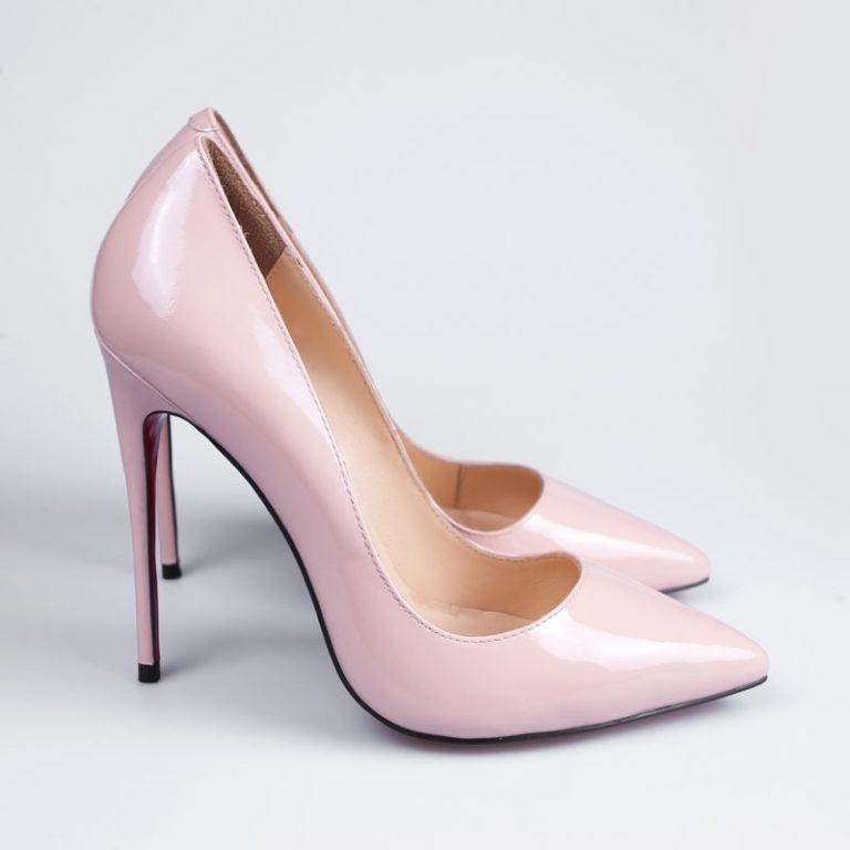 Pink stylish shoes isolated on white