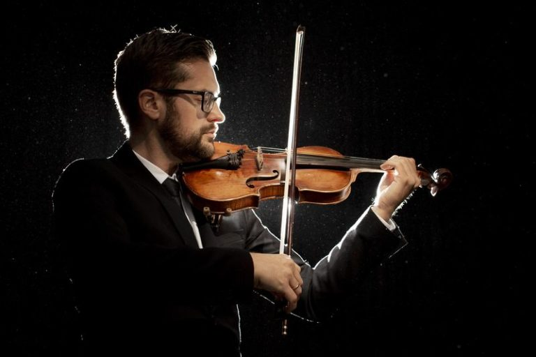 side-view-male-artist-playing-violin