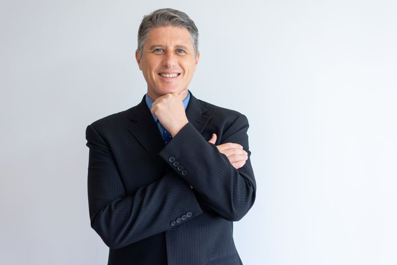 Portrait of positive confident businessman