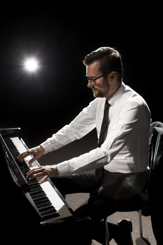 side-view-male-musician-playing-piano