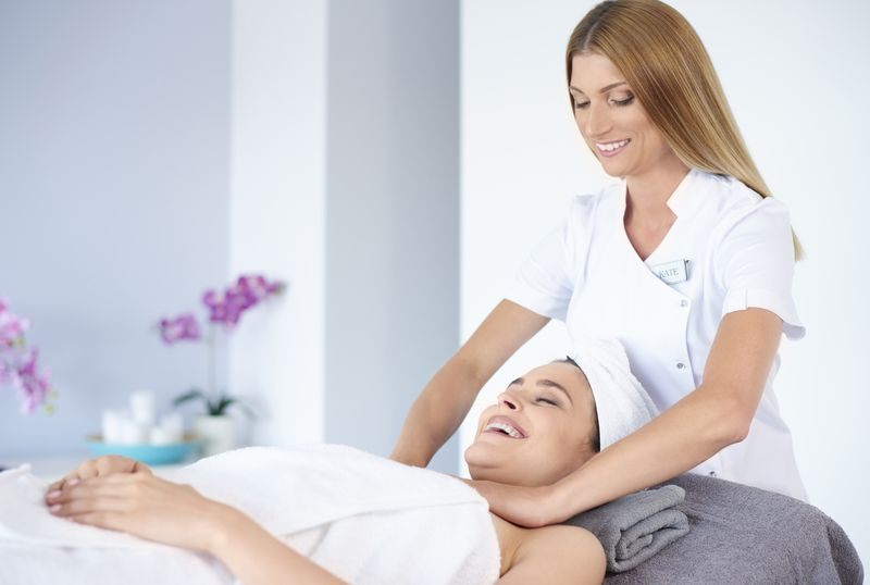 Cheerful woman receiving a masagge