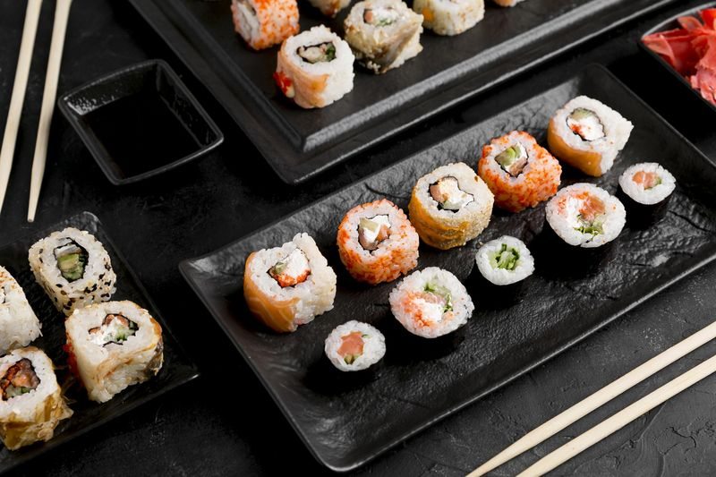 flat-lay-delicious-sushi-with-sauce