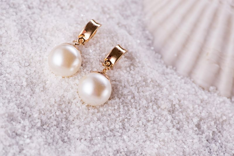 Golden earrings and sea shell